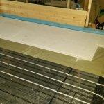 Plaques de distribution de chaleur pour le chauffage par le sol à eau